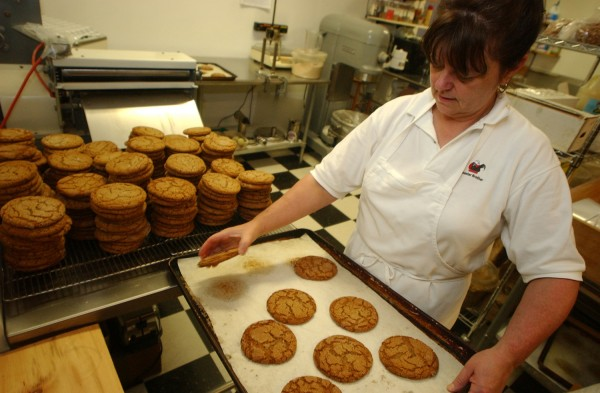 Elaine Webb stacks cookies to be offered for sale at Rooster Brother in Ellsworth in August 2004.