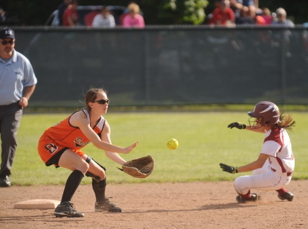 Bangor High School's Jade Baumrind steals second base before Brewer High School's Lindsay Houp, left, can get the throw during the seventh inning of their Eastern Maine softball semifinal at Bangor High School Saturday afternoon, June 9, 2012. The Brewer High School Witches prevailed 7-1.