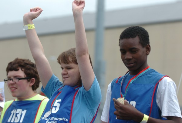 Amber Hyson (center), 11, of Boothbay shows her joy after receiving her medal the 4x100 meter relay Friday, June 8, 2012 at the Maine Special Olympics Summer Games which take place at the University of Maine in Orono through Sunday. Other competitors on the victory platform include Abdi Dagane (right), 15, a rising sophomore at Lewiston High School.
