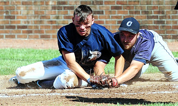 T.J. Frost is safe at home after Calais' pitcher Adam Geel stepped up to protect the plate in the Class C State Baseball Championship on Saturday at Saint Joseph's College in Standish. The Cougars took the title 6-1.