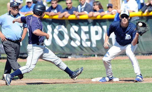 Calais' Adam Geel makes it back to first base safely as Dirigo's Cody St. Germain waits for an attempted pick-off in the Class C State Baseball Championship on Saturday at St. Joseph's College in Standish. The Cougars took the title 6-1.