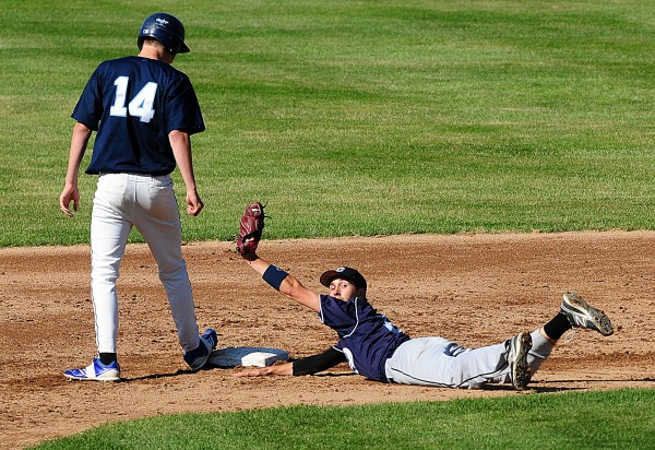 Justin Craig ended up sliding into second on an unsuccessful pick-off of Dirigo's Cody St. Germain in the Class C State Baseball Championship on Saturday at Saint Joseph's College in Standish.  The Cougars took the title 6-1.