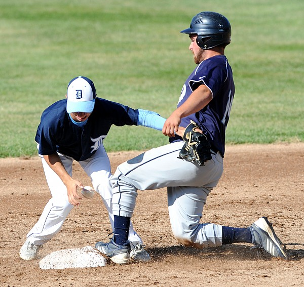 Dirigo's Hunter Ross drops the ball as Adam Geel steals second in the Class C State Baseball Championship on Saturday at Saint Joseph's College in Standish.  The Cougars took the title 6-1.