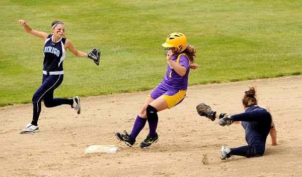 Dirigo's Natasha Deroche (right) is backed up by Natalie Bolduc as she reaches out in an attempt to tag out Sadie Wight on her way to second in the Class C State Softball Championship on Saturday, June 16, 2012 at Saint Joseph's College in Standish. Wight was safe and the Golden Bucks went on to win 2-0.