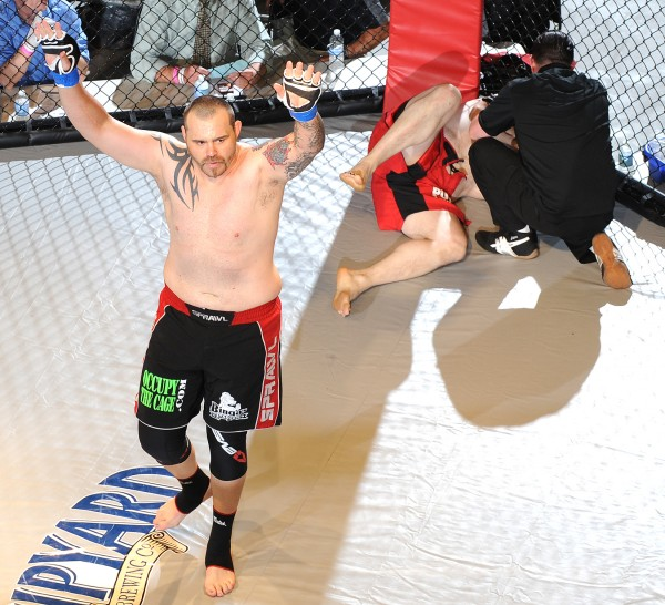 Tim Sylvia celebrates after knocking out Randy Smith in 12 seconds of the first round of the main event of Fight Night III, a MMA Cagefighting event presented by New England Fights at the Androscoggin Bank Colisee in Lewiston Saturday night.
