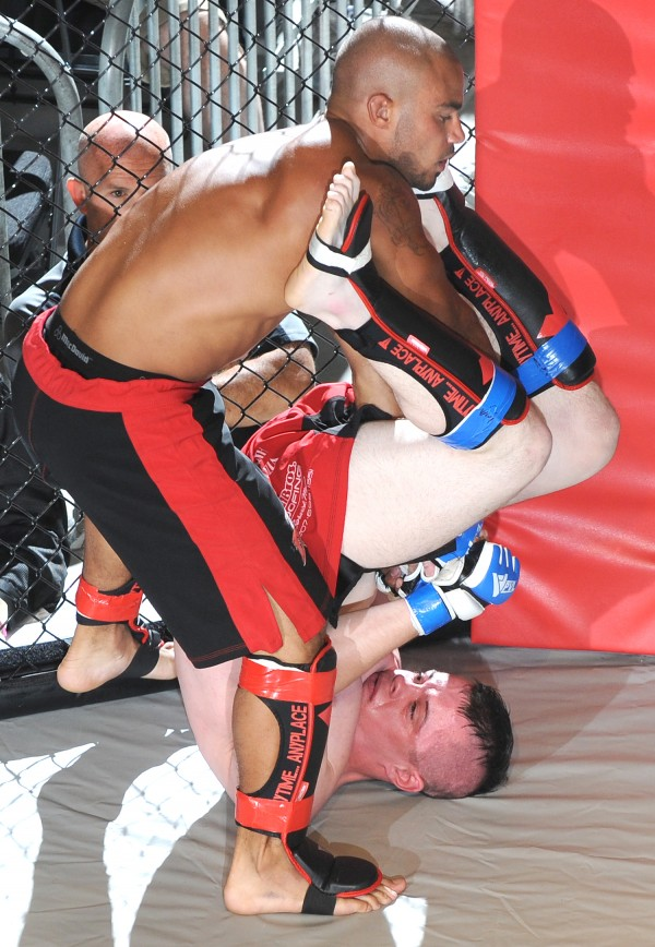 John Healey, bottom, rolls out of a hold by Cleon Hoggard, top, during Fight Night III, a MMA Cagefighting event presented by New England Fights at the Androscoggin Bank Colisee in Lewiston Saturday night. Healey ended up winning when Hoggard tapped out while in a choke hold.