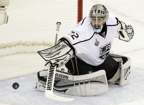Jonathan Quick of the Los Angeles Kings stops a shot on goal during the first period of Game 2 of the Stanley Cup finals against the New Jersey Devils on Saturday, June 2, 2012, in Newark, N.J.