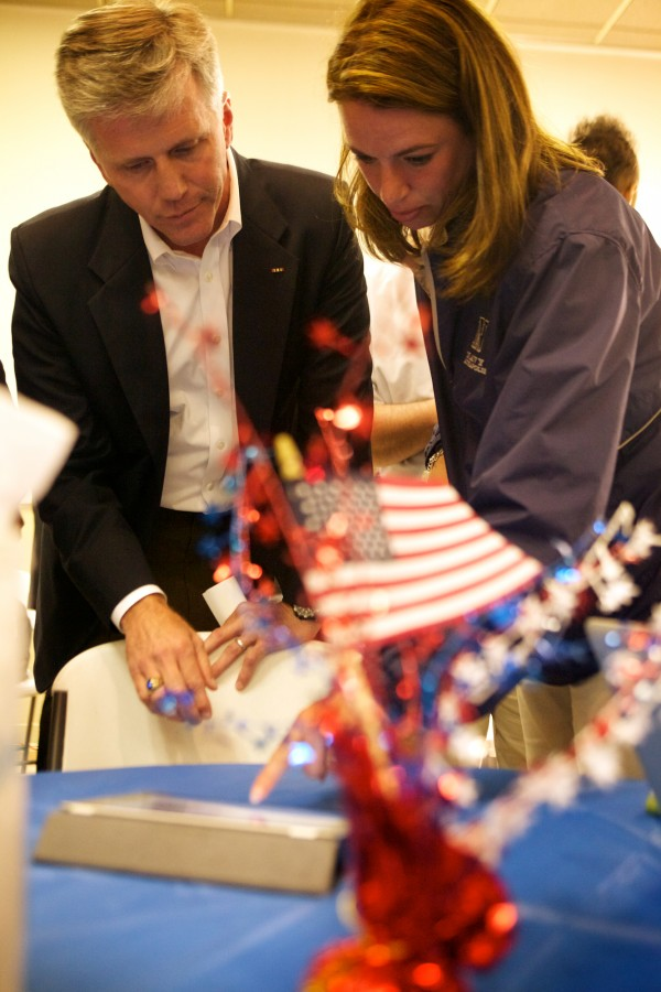 U.S. Senate Republican hopeful Charlie Summers checks the early returns at bangordailynews.com with wife Ruth at his headquarters in South Portland on Tuesday night June 12, 2012.