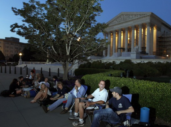 People line up in front of the U.S. Supreme Court on Wednesday evening in anticipation of  Thursday's expected ruling on whether the Affordable Care Act passes the test of constitutionality.