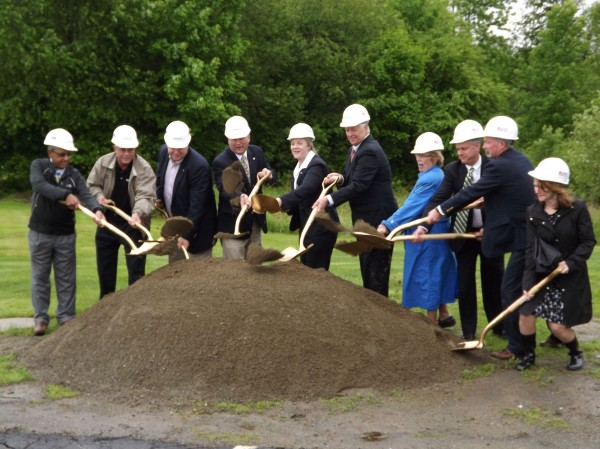Sebasticook Valley Hospital President and CEO Victoria Alexander-Lane (fifth from left) and Rep. Mike Michaud (sixth from left) break ground on a project that will expand the hospital's inpatient care wing. Members of the hospital's board of trustees also throw dirt in a rainy ceremony in Pittsfield on June 4, 2012.