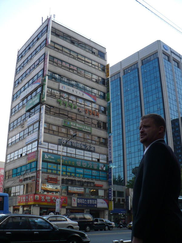 Wade Merritt, director of operations at the Maine International Trade Center in Portland, stands in Seoul's Myeong-Dong section, which is filled with food and clothing vendors, in October 2007.