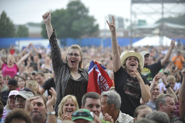 Lynyrd Skynyrd fans Rachel Malcolm (left) of Trenton and Jamie Tate-Copeland whoop it up with thousands of others as Charlie Daniels arrives onstage as the opening act for the Hollywood Slots Waterfront Concert Series in August 2010.