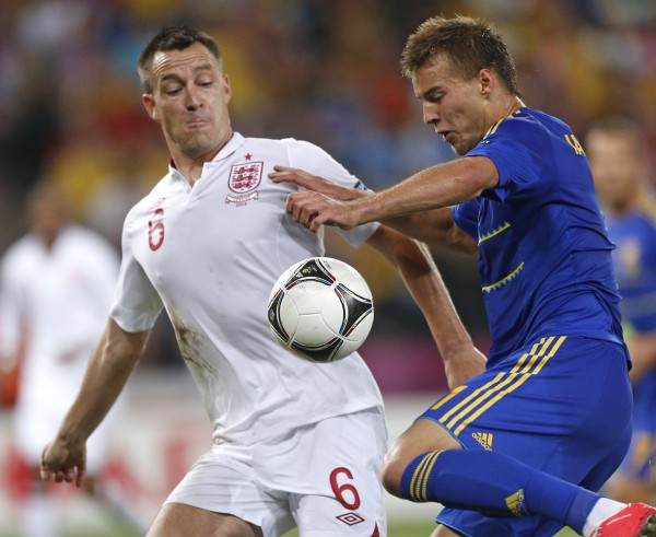 England's John Terry (left) and Ukraine's Andriy Yarmolenko duel for the ball during the Euro 2012 soccer championship Group D match between England and Ukraine in Donetsk, Ukraine, Tuesday, June 19, 2012.