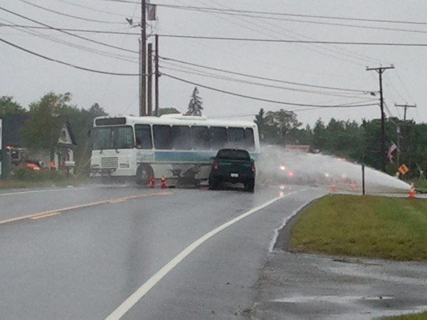Route 3 in Trenton was shut down Wednesday afternoon, June 13, 2012, while firefighters tried to make sure an Island Explorer bus didn't explode after it was struck by a small pickup truck. Island Explorer buses are powered by propane gas, and this one was struck where its tank is located.