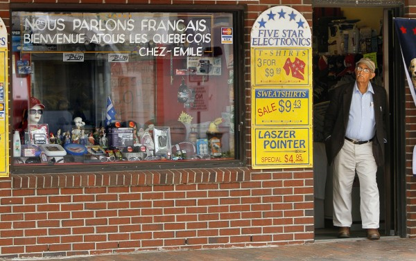 In this May 26, 2011 photo, a message on a storefront window says &quotWe speak French&quot and welcomes French-Canadians to Old Orchard Beach, Maine.