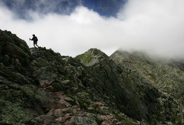 A hiker makes his way across the Knife Edge, a narrow serrated ridge leading to the summit of Mount Katahdin, during the summer of 2006.