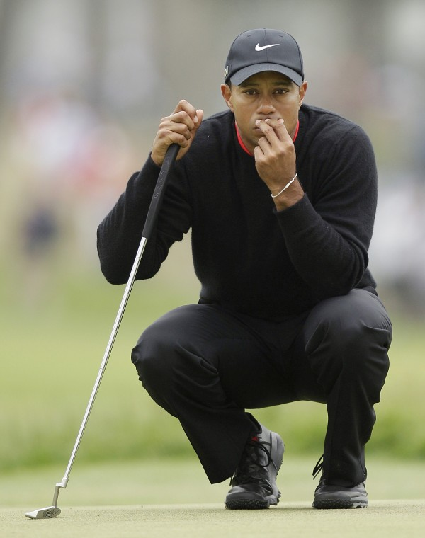Tiger Woods waits to putt on the ninth hole during the fourth round of the U.S. Open Championship golf tournament Sunday, June 17, 2012, at The Olympic Club in San Francisco.