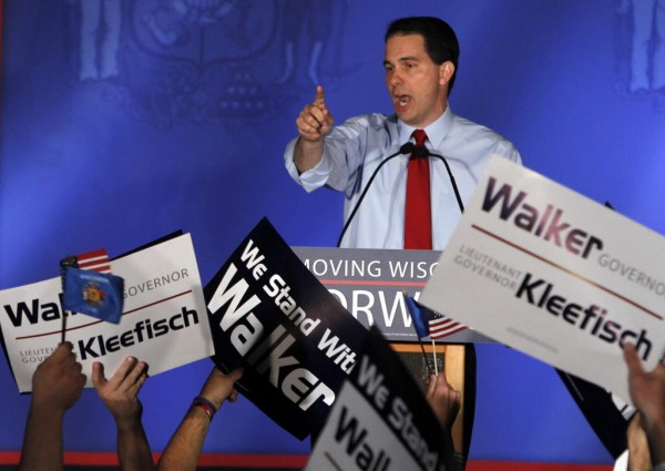 Gov. Scott Walker celebrates after his win Tuesday over Tom Barrett in a recall election at a rally at the Waukesha Expo Center in Waukesha, Wis.
