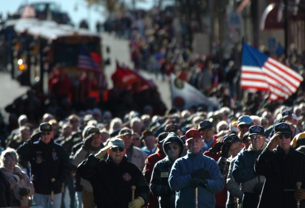 As the national anthem was played, Maine's World War II veterans and other members of the military and public safety community joined thousands of spectators as they saluted the U.S. flag during the 2010 Brewer-Bangor Veterans Day Parade.