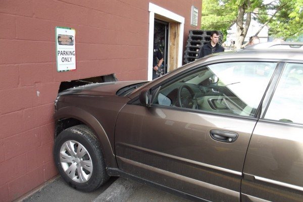 An unidentified woman drove her Subaru Outback through a wall at Brewer Redemption Center on North Main Street shortly after 4 p.m. Thursday.