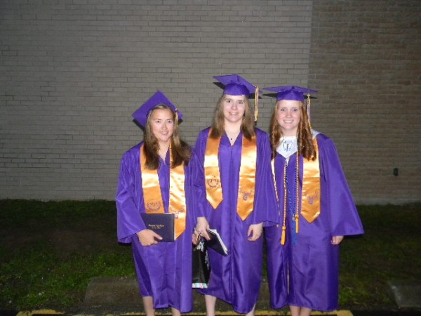 Jennifer Wight (from left), Shelby Wight and Kelly Wight -- triplets from Bucksport -- pose for a graduation picture on Friday, June 8, 2012.