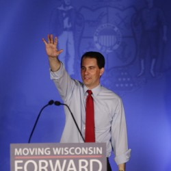 In Wisconsin recall vote, dollars vs. door-knocks