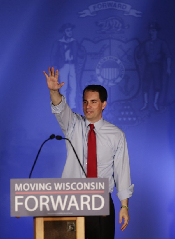 Wisconsin Republican Gov. Scott Walker waves at his victory party Tuesday, June 5, 2012, in Waukesha, Wis.
