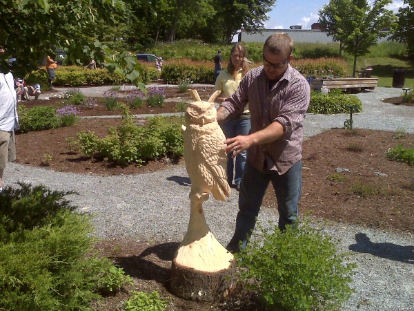 Chain-saw-wielding woodcarver Josh Landry created an owl sitting on a branch from a piece of white pine for the Brewer Children's Garden on Saturday, June 9, 2012, during a bicentennial celebration held at the garden that also included live music, crafts, pumpkin seed plantings and a live creature presentation by &quotThe Bug Guy,&quot Bangor naturalist Tony Sohns.