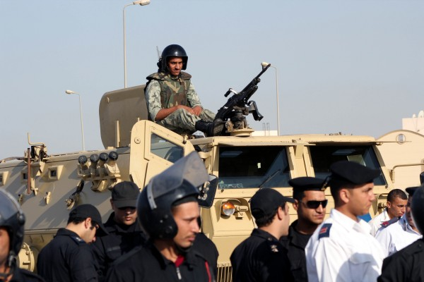 Egyptian military, central security and police forces guard former Egyptian President Hosni Mubarak's verdict session in Cairo, Egypt, Saturday, June 2, 2012. Mubarak was sentenced to life in prison.