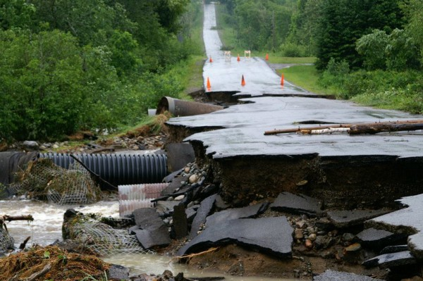Damage is shown on the Waters Road in Patten from steady rain that began on Sunday. Flood warnings, watches or hazardous weather advisories were in effect for the state Tuesday, June 26, 2012, as some areas picked up more than eight inches of rain since the storm began.
