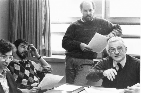 Jim Emple (from left), Eric Zelz, Rick Levasseur and Kent Ward confer during an editorial meeting in 1990.