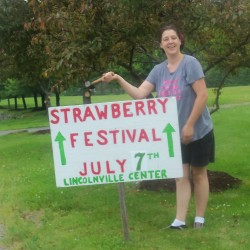 Tracee O'Brien of Lincolnville hammers a directional sign into the ground to help visitors find their way to the 18th Annual Old Fashioned Strawberry Festival July 7.