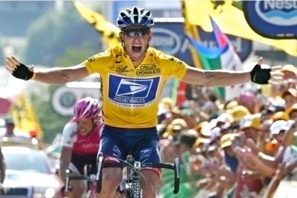 Lance Armstrong reacts as he crosses the finish line to win the 17th stage of the Tour de France cycling race between Bourg-d'Oisans and Le Grand Bornand in the French Alps. As a result of new formal charges, Armstrong has been immediately banned from competition in triathlons, a sport he took up after his retirement from cycling in 2011.