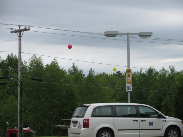 Five weather balloons used Thursday morning to show the height and visibility of the controversial proposed liquid propane gas project were seen from the Irving gas station on Route 1.