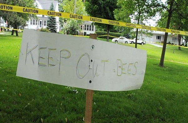 A sign warning people to stay out of a taped section of Fairmount Park in Bangor can be seen on Wednesday, June 20, 2012, after officials had the area sprayed with pesticides to discourage bees that had been spotted in the area.