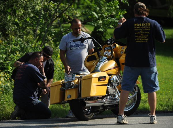 Friends of Theodore McLeod gather around his Harley Davidson to inspect  the damage after McLeod laid the bike down to avoid running into the back of a stopped pickup truck waiting to make a turn onto North Street from Route 2 in Hermon on Wednesday, June 20, 2012. McLeod was taken to EMMC for treatment.
