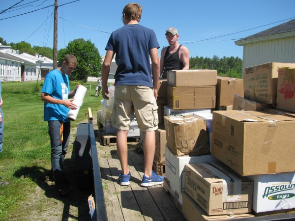 Seniors at Searsport District High School boxed, wrapped and loaded books Friday morning at the end of a two-month-long book drive done by the students. Altogether, the 30 graduating seniors will be donating between four and five thousand pounds of books to a Utah-based philanthropic business that will distribute them to needy people.