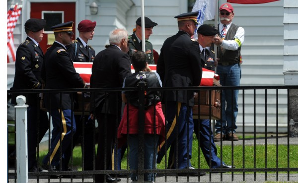 The casket containing the remains of John &quotJay&quot Brainard is carried into St. Anne's Roman Catholic Church in Dexter on Saturday, June 16, 2012 for a full military service.