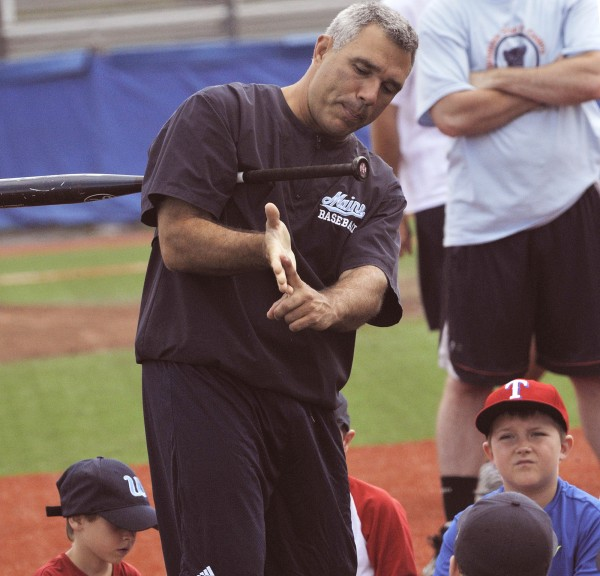 Maine baseball head coach Steve Trimper describes the basics of a good bat-grip to baseball campers at Mahaney Diamond, Orono, Thursday, June 28, 2012.