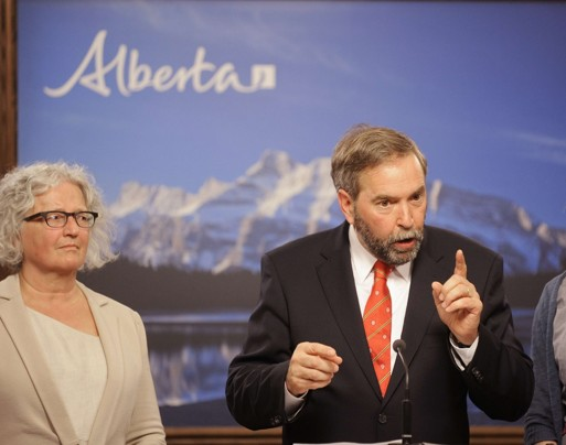 New Democratic Party leader Thomas Mulcair, right, speaks at the Alberta Legislative Building in Edmonton on Thursday after an aerial tour of the Alberta oil sands.