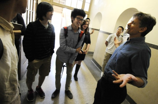 Craig Butler, director of John Bapst Memorial High School's international program, gathers with students who hail from China, South Korea, Vietnam and England Friday afternoon, June 1, 2012.