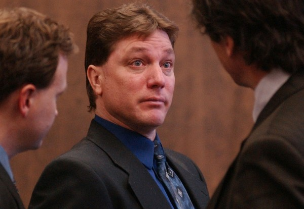 A teary-eyed Jeffrey Cookson (center) talks briefly with his attorneys, Steve Brochu (left) and William Maselli, after his sentencing for the slaying in December 1999 of his ex-girlfriend Mindy Gould, 20, and the boy she was babysitting, Treven Cunningham, 21 months old, both of Dexter.