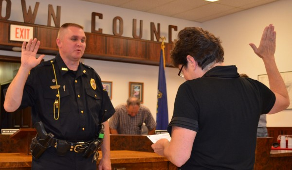 Kevin Wintle gets sworn in by Dexter Town Manager Linda-Jean Briggs as the town's police chief during a ceremony on Wednesday, June 27, 2012. Wintle had served as Dexter's police chief in an interim capacity since February.