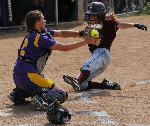 Bucksport catcher Mindy Pye blocks the plate and tags out Caribou's Jamie Martin during a game last season. Pye is one of four finalists for the Miss Maine Softball award given to the state's top senior.