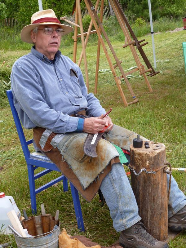 Richard Scott teaches a class on scythe maintenance on Saturday, June 16, 2012 at Farm and Homestead Day at the Maine Organic Farmers and Gardeners Association fairgrounds in Unity.