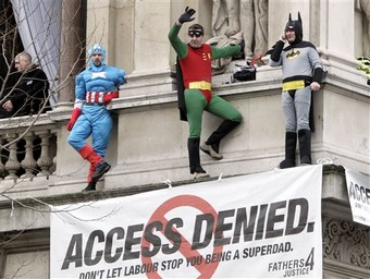 Three members of a group that campaigns for improved rights for fathers climb onto a ledge at the Foreign Office in central London, on Monday, Feb. 28, 2005