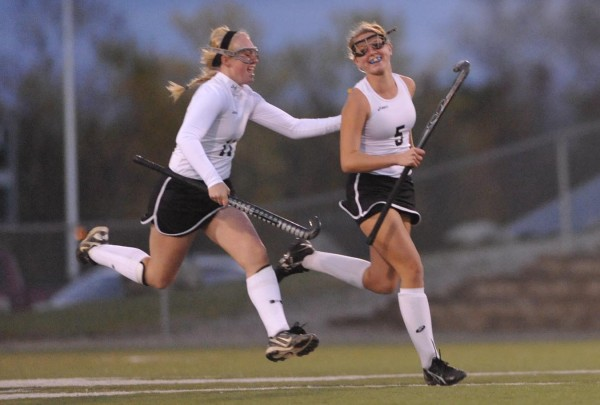 Skowhegan's Mikayla Fitzmaurice (left) and teammate Nicole Sevey celebrate after Fitzmaurice scored the first goal at the beginning of the first half of the Eastern Maine Class A field hockey championship in Hampden Tuesday evening, Oct. 25, 2011. Skowhegan defeated Messalonskee 2-1.