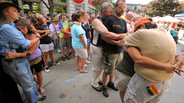 Same-sex couples embrace during a commitment ceremony at West Market Square in Bangor during the second annual Pride Festival Saturday. Any gay or straight couple was invited to participate in the ceremony.