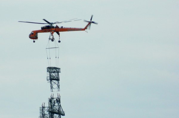 Helicopter used to install CMP towers for power lines across
