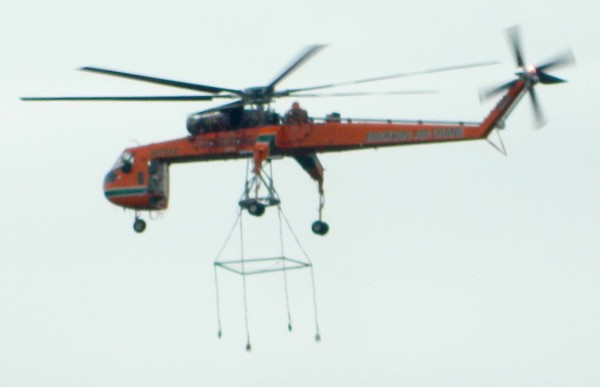 An aerial lift helicopter places tower sections that will hold power lines on the Bucksport-Orrington line.